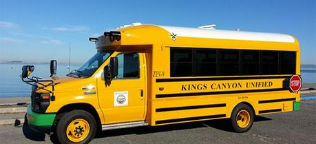 Electric school buses that feed the power grid could save school districts millions