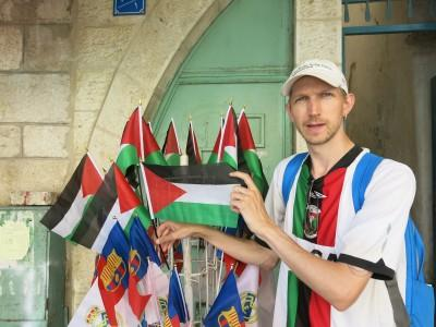 Posing with the Palestine Flag - don't forget where you are when you end up in Bethlehem.