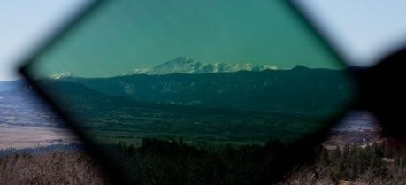 Rocky Mountains seen through the New Energy Technologies' electricity-generating SolarWindow