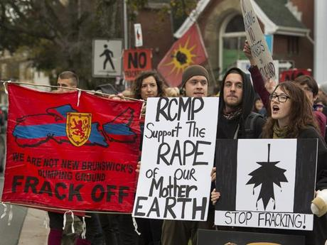 Demonstrators rally against shale gas exploration on Friday, Oct.18, 2013, in Halifax. The effort was in support of protesters, some of whom included members of the Elsipogtog First Nation, who rallied against SWN Resources and its possible plans to proceed with shale gas development in eastern New Brunswick. Photo: THE CANADIAN PRESS / Andrew Vaughan