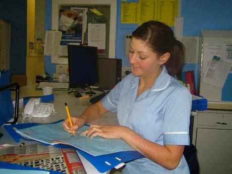 Staff_Nurse_Andrea_writing_up_her_notes