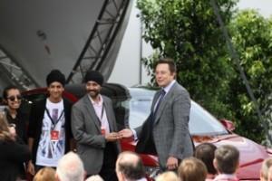 Elon Musk handing the keys