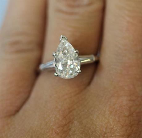 Pear shaped engagement ring with baguettes