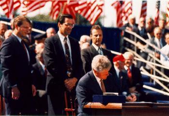 English: President Bill Clinton signing the No...