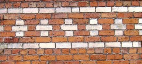 Photo of a brick wall, illustrating the quantum well concept.