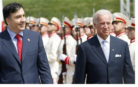 U.S. Vice President Biden and Georgia's President Saakashvili review a honor guard during a welcoming ceremony in Tbilisi