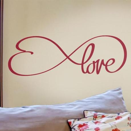 Simple and elegant love wall decal featuring a heart detail from Cozy Wall Art.