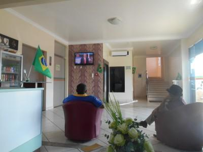 At the hotel reception in Hotel Mais, Macapa watching France dick Switzerland.