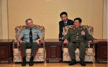 VMar Hwang Pyong So, Director of the KPA General Political Department (right), meets with Lt. Gen. Valery Khalilov in Pyongyang on 2 July 2014 (Photo: Rodong Sinmun).