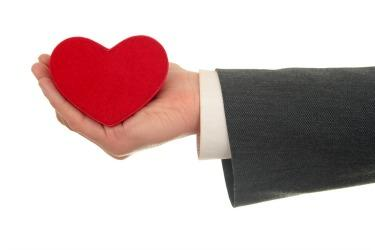 business person holding a heart
