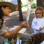Park ranger teaching young girl
