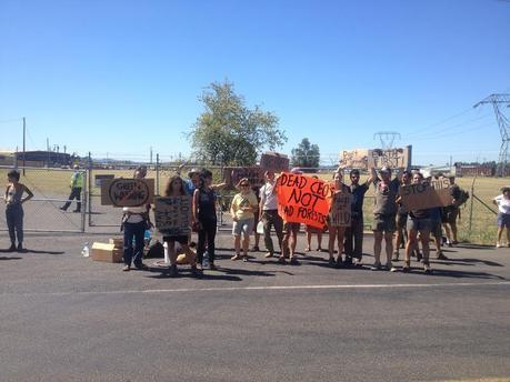 Protesters gathered outside the facility to voice their opposition to Seneca Jones' dirty practices.