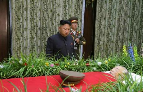 Kim Jong Un stands in front of Jon Pyong Ho's casket at the Sojang Club in Pyongyang on 9 July 2014 (Photo: Rodong Sinmun).