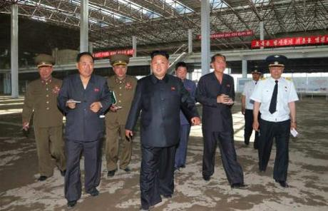 Kim Jong Un tours the construction of Terminal #2 at Pyongyang Airport.  Also seen in attendance are VMar Hwang Pyong So (1st left), Ma Won Chun (3rd left) and Director of the DPRK General Bureau of Civil Aviation Kang Ki Sop (2nd right) (Photo: Rodong Sinmun).