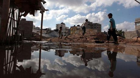 Palestinians inspect a house destroyed in air attacks staged by the Israeli army in Gaza City, Gaza, July 14, 2014. Ashraf Amra/Anadolu Agency/Getty Images