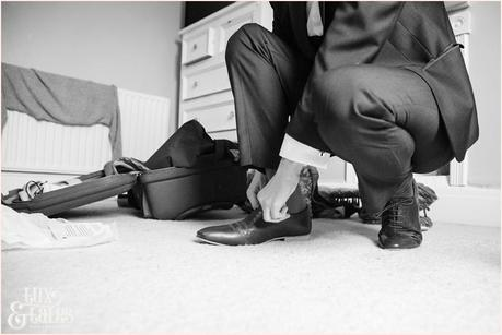 Groom gets ready at yorkshire wedding shoe
