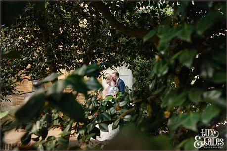 Bride and groom kiss in Orangery at Yorkshire Sculpture Park