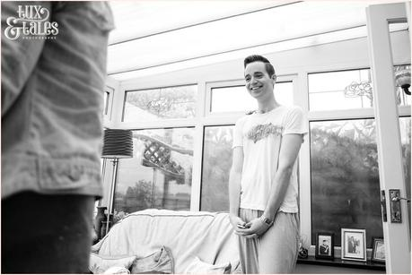 Friend looks on as bride prepares for yorkshire wedding.