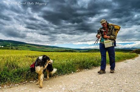 Camino Portraits: A pilgrim and his dog