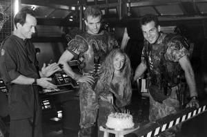 Lance-Henriksen-Michael-Biehn-and-Bill-Paxton-celebrating-Louise-Head's-Carrie-Henn's-stunt-double-birthday-on-the-set-of-Aliens