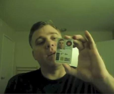 Shawn Weed with his military ID card
