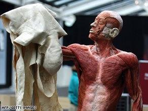 Human body holding up his own removed skin.