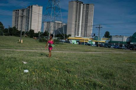A girl walks along the Finch Hydro Corridor recreational trail. Every day hundreds of people traverse and use the area above the Line 9 pipeline. Photo from Briarpatch Magazine