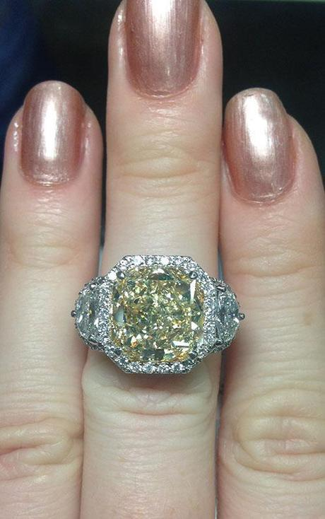 Fancy yellow diamond ring with white half moons