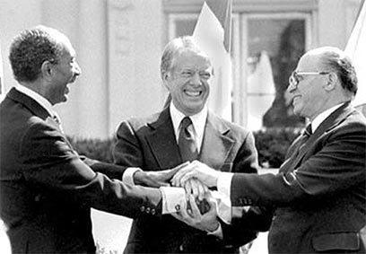 Signing the accords on the White House lawn 11-19-77