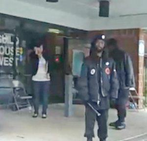 Billy cub-wielding Black Panthers at a Philadelphia polling station, 2008