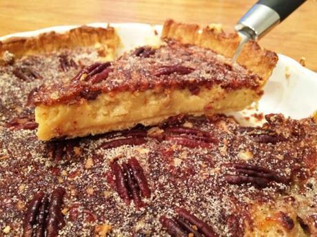 slice of salted caramel pecan pie served warm